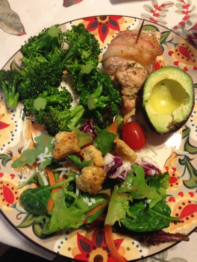Bacon wrapped rosemary chicken with broccoli, salad and avocado